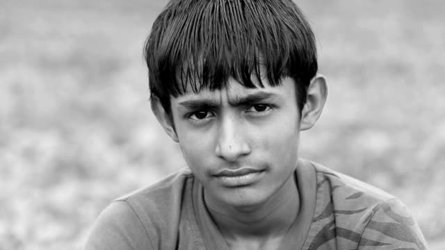 Young boy looking at camera portrait video