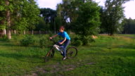 Young boy moving riding on sports bike. The camera moves  with  steadicam  behind him. video