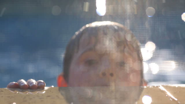 Young boy playing by the poolside video