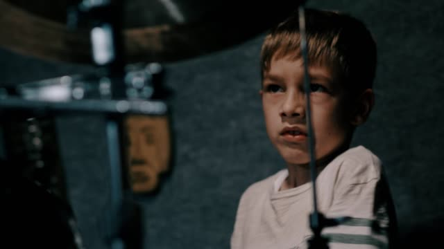 Young boy playing drums, front view video
