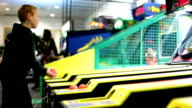 Young Boy playing Skee Ball video