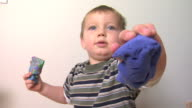 Young boy playing with play dough video