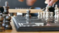 young boy set the chess on a chessboard video