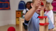 Young boy stacking blocks video