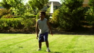 Young boy tries to catch football video