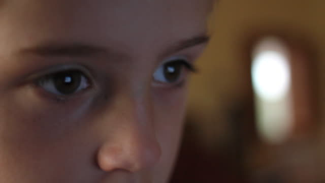 Young boy watching TV video