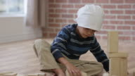 Young Boy with Cancer Playing with Blocks video