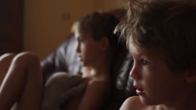 Young boys watching TV video
