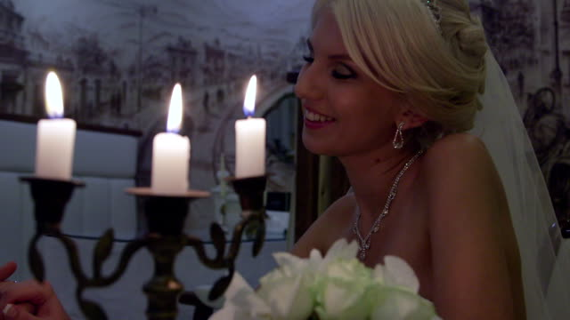 Young bride by candlelight video