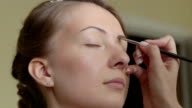 Young bride getting her makeup video