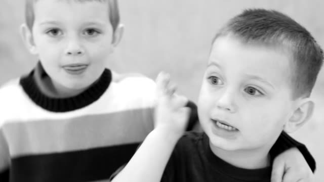 Young brothers, black and white portrait video