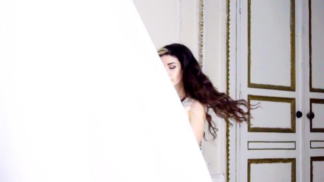 Young brunette woman dances in long evening dress video