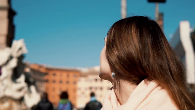 Young brunette woman sitting at the Navona square. Girl enjoying the sunny day in Rome, Italy video