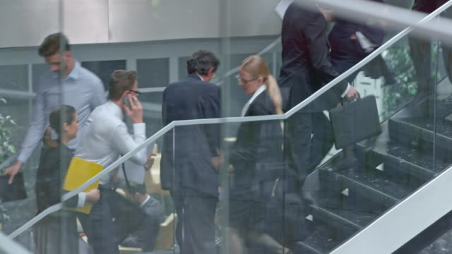 DS Young business man overpassing people up the stairs video