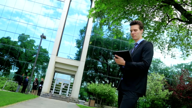 Young Business man uses a tablet video