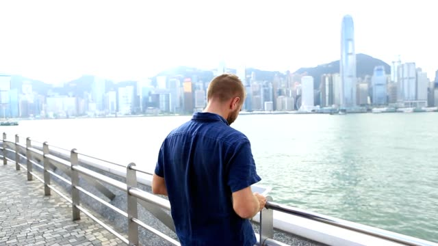 Young business man using digital tablet in Hong Kong video