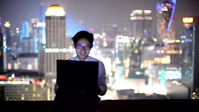 Young business man using laptop Online shopping with smart phone video