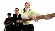 Young business men and woman playing tug-of-war, Slow Motion video