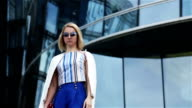 young business woman in short blue trunks video