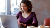 Young business woman sitting in cafe video