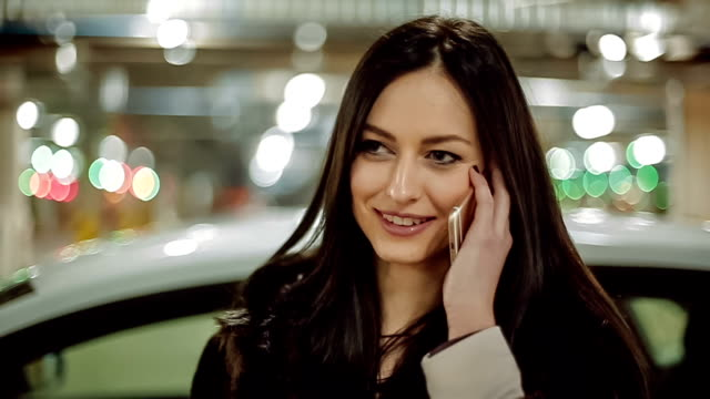 Young business woman talking on the phone. Slow Motion video