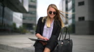 Young business woman using digital tablet video