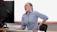 Young business woman with back pain video