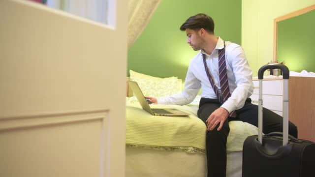 Young businessman being prepared for a business travel video