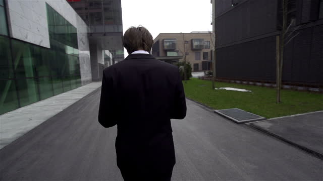SLOW MOTION: Young businessman gets good news over digital tablet video