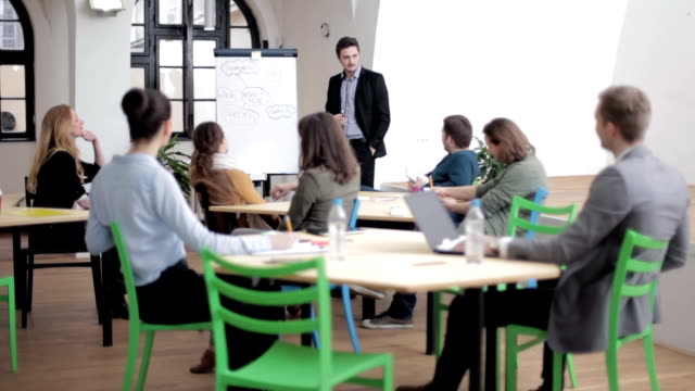 Young businessman holding training video