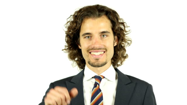 A young businessman is engaged in a video call with a client video