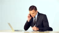 Young businessman making notes in a notebook video