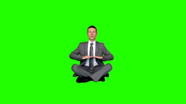 Young businessman meditating, Green Screen video