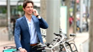 Young businessman parking his bicycle video