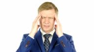 Young businessman suffering from headache touching temples over white background video