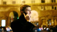 young businessman talking on a cell phone video