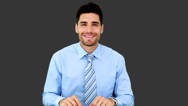 Young businessman talking to camera video