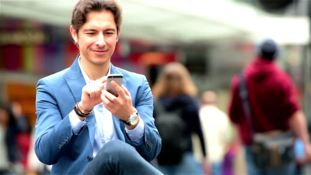 Young businessman texting in the city video