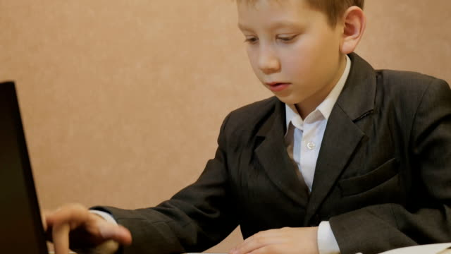 Young businessman using a laptop video