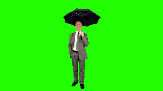 Young businessman with umbrella, Green Screen video