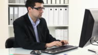 Young businessman working in office video