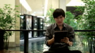Young businessman working on tablet computer video