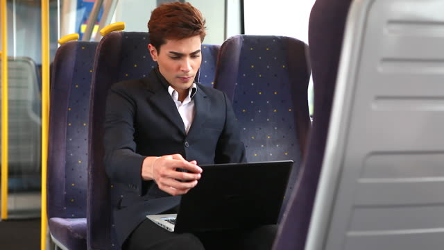Young businessman working on the train. video