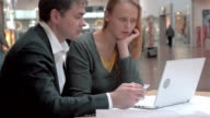 Young businesspeople deep at work video