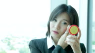 Young Businesswoman Applying Make-Up video
