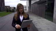 Young businesswoman gets good news over digital tablet video