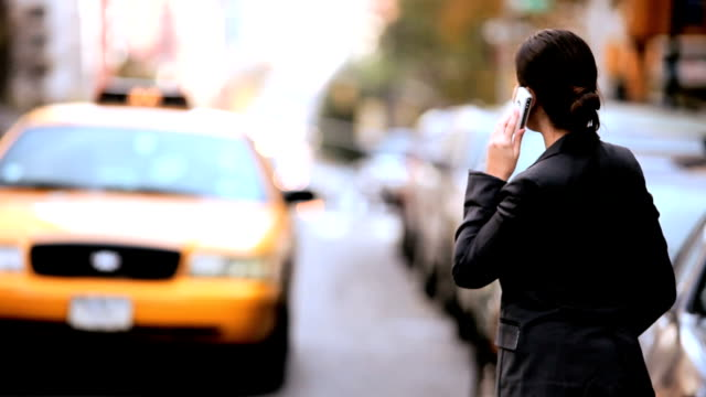 Young Businesswoman Hailing a Cab video