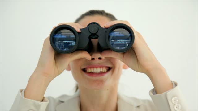 Young businesswoman looking through binoculars video
