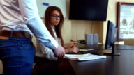 Young businesswoman overwhelmed by too much paperwork in office video