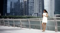 Young Businesswoman Talking Smartphone on Bridge video
